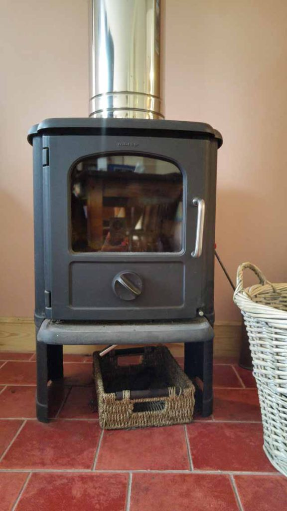 Freestanding stove on tiled hearth