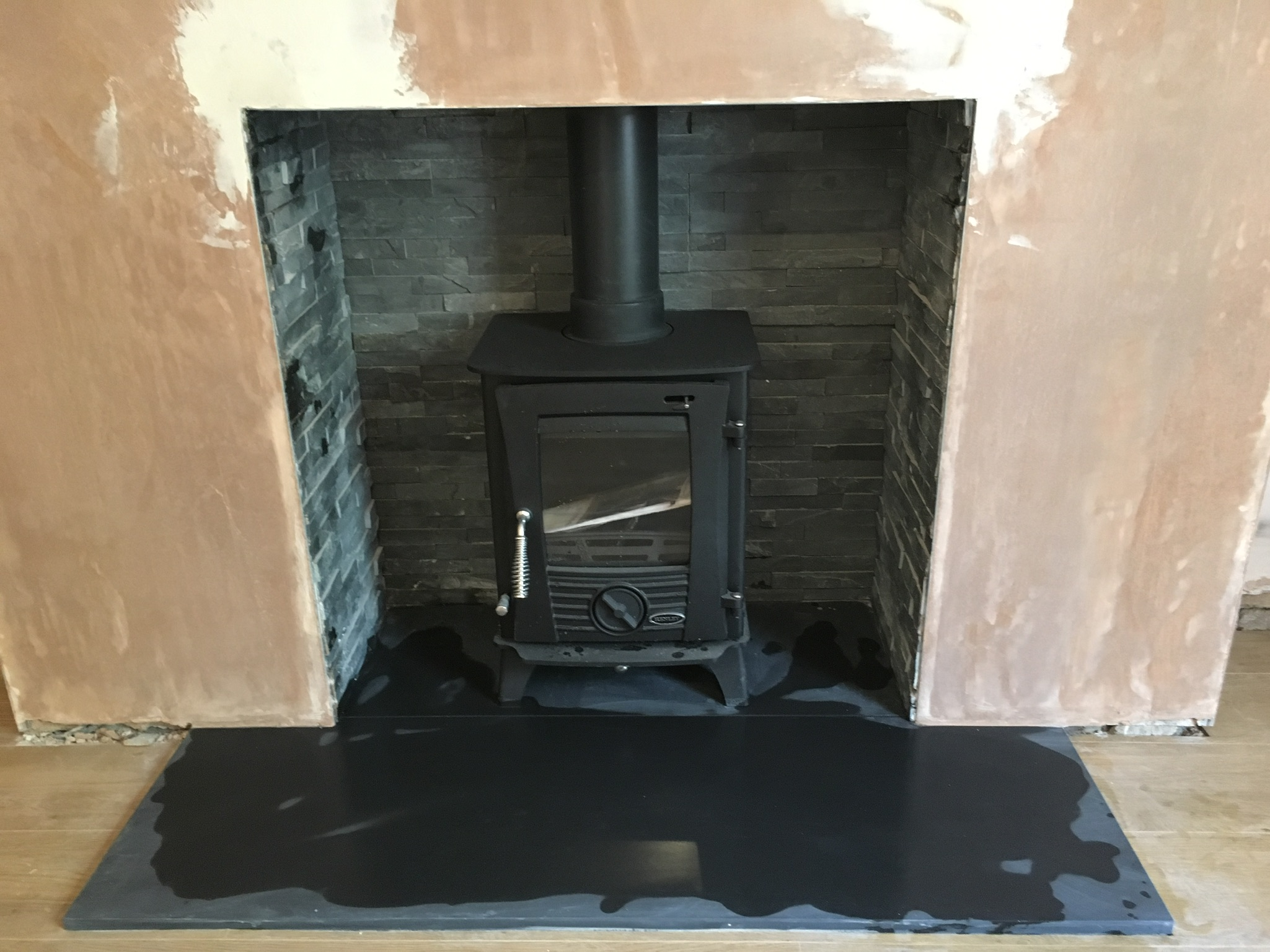 Stove with slate tiled fireplace back