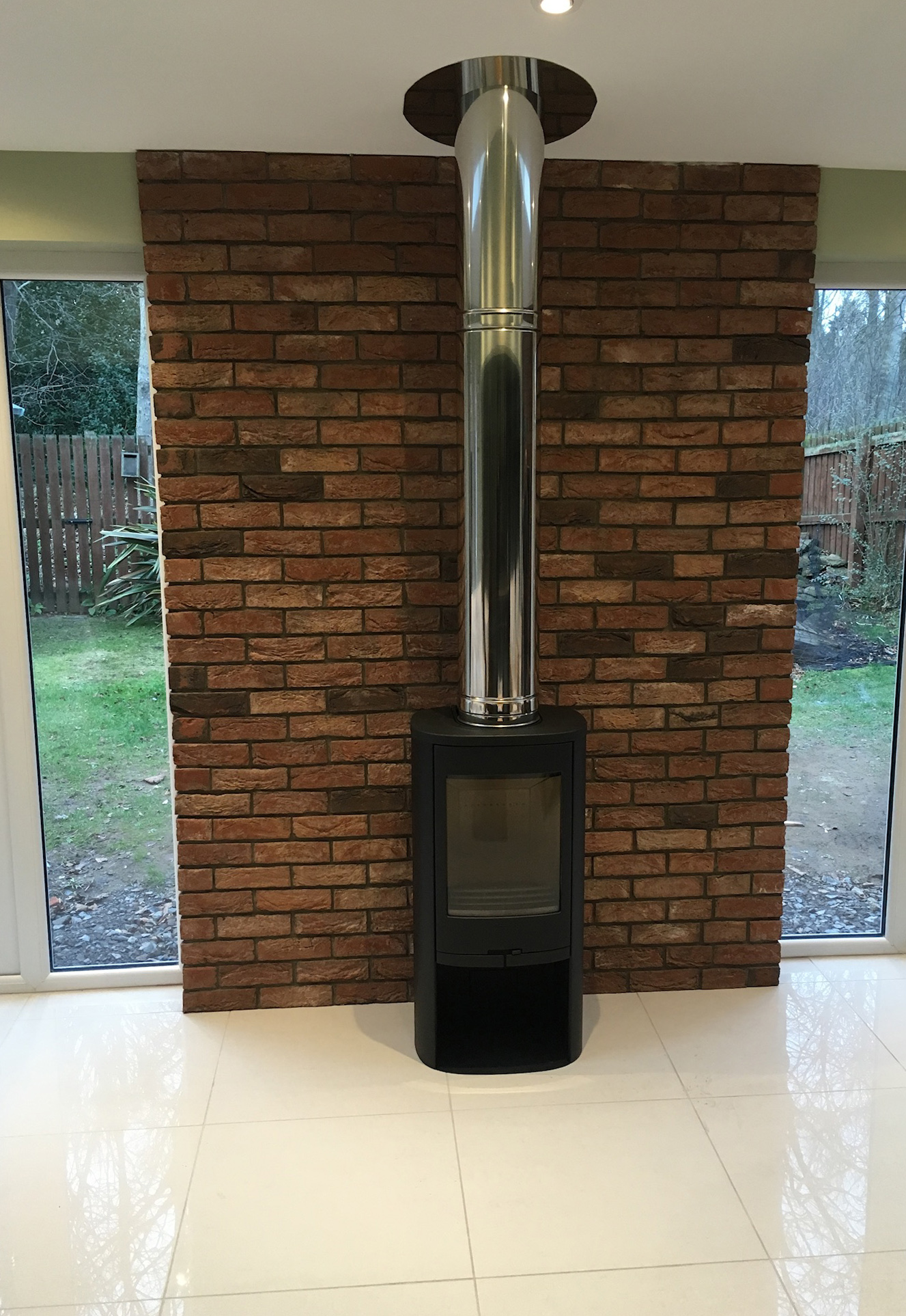 Freestanding stove with exposed brick feature wall