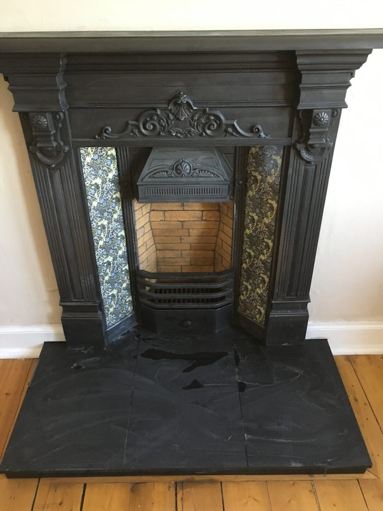 Fireplace with blue tiles