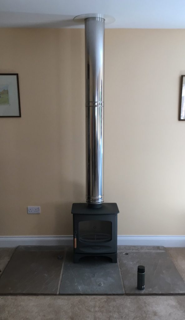 Freestanding stove with steel flue
