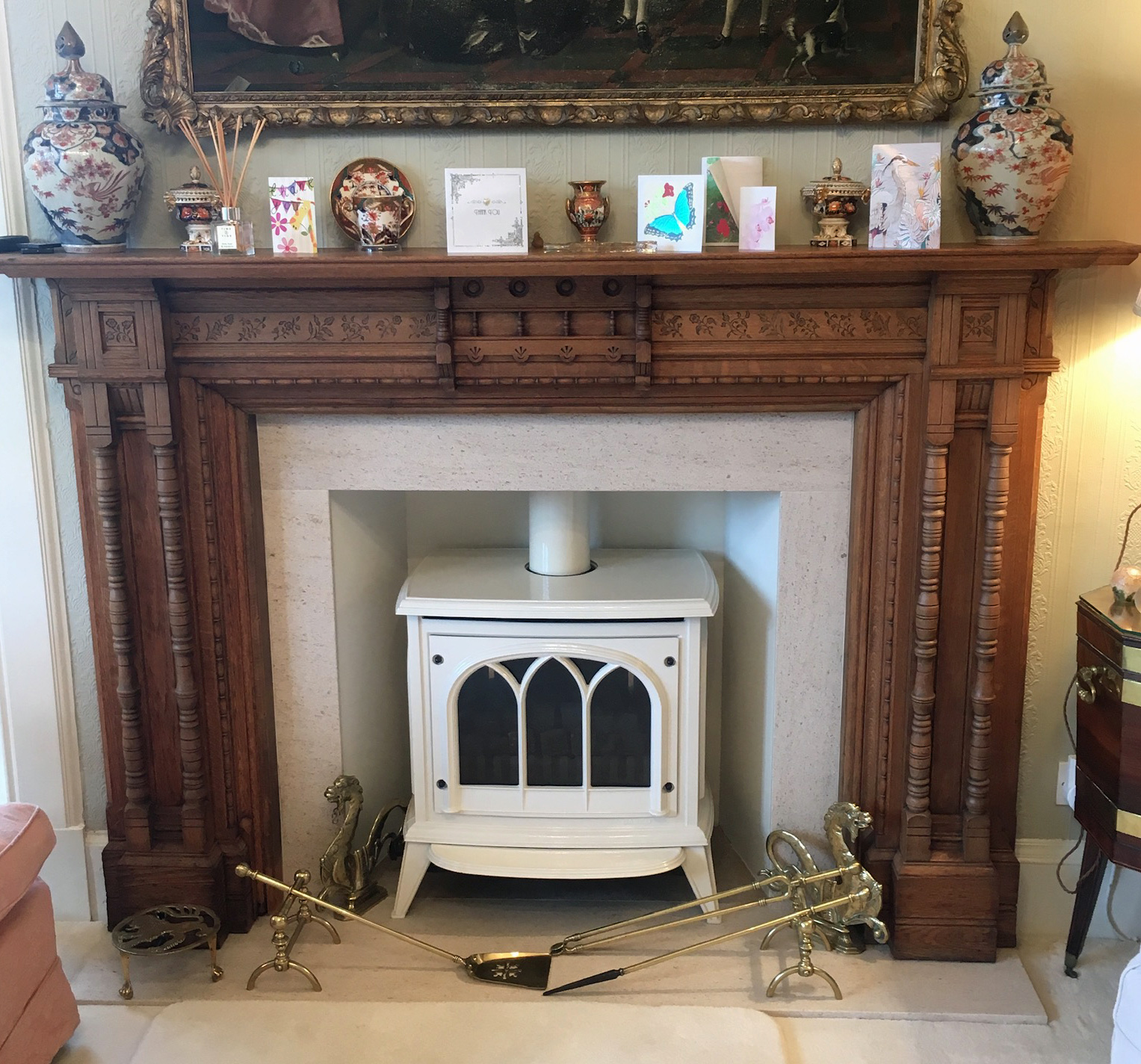 White stove with wood mantlepiece