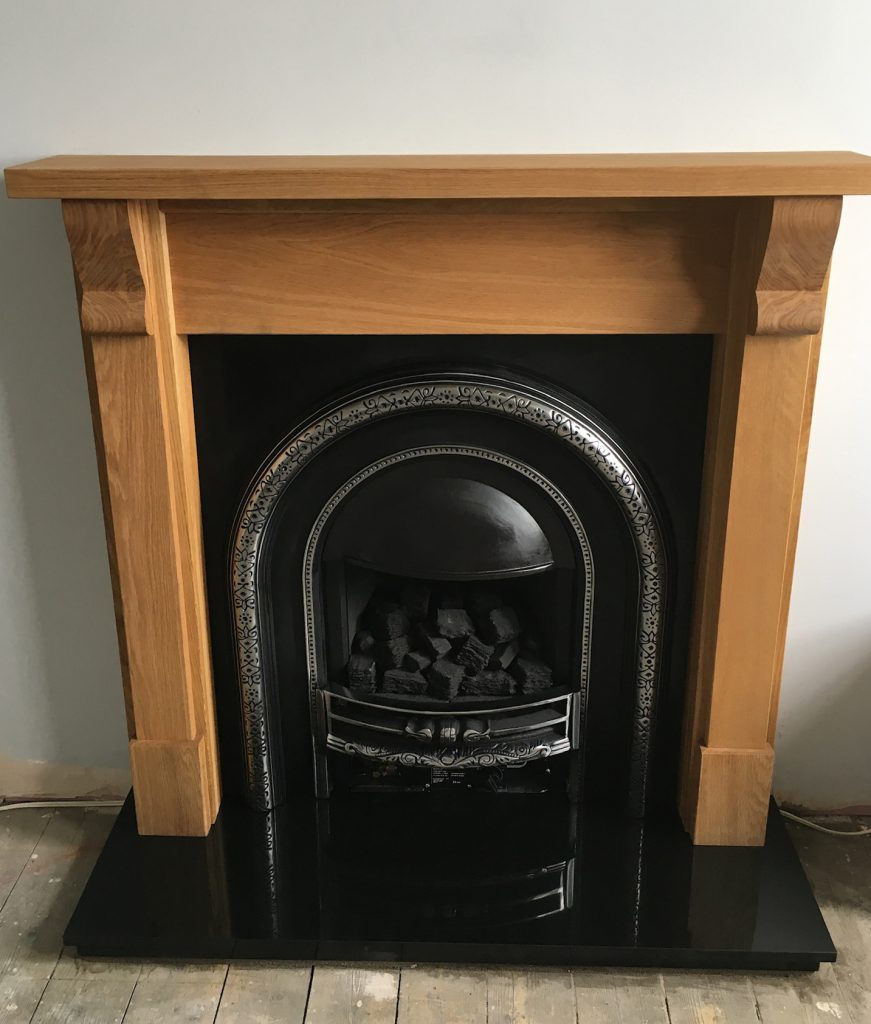 Fireplace with wood mantlepiece