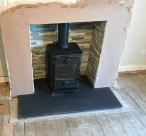 Stove with tiled back fireplace