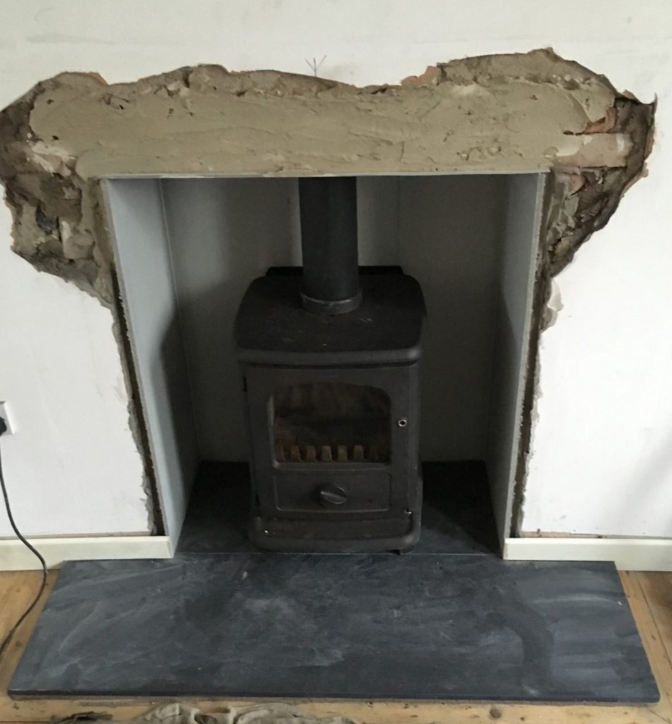 Stove installed, plaster-work to be completed