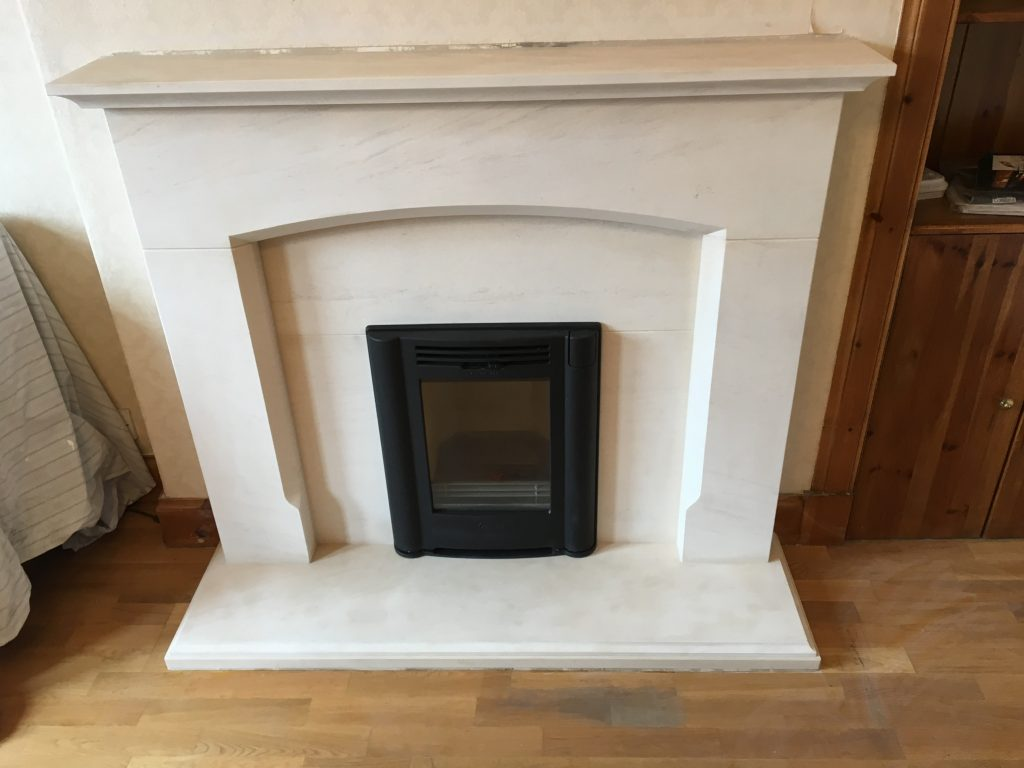 Inset stove with white surround