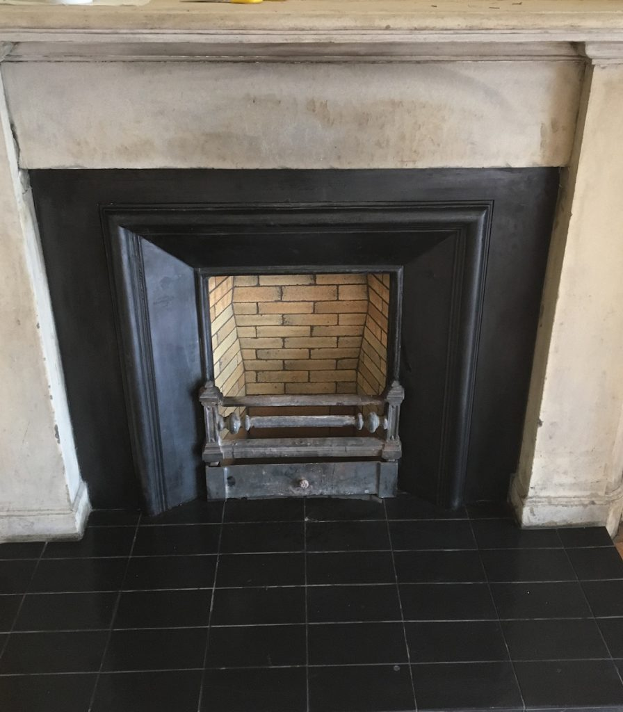 Fireplace with brick back