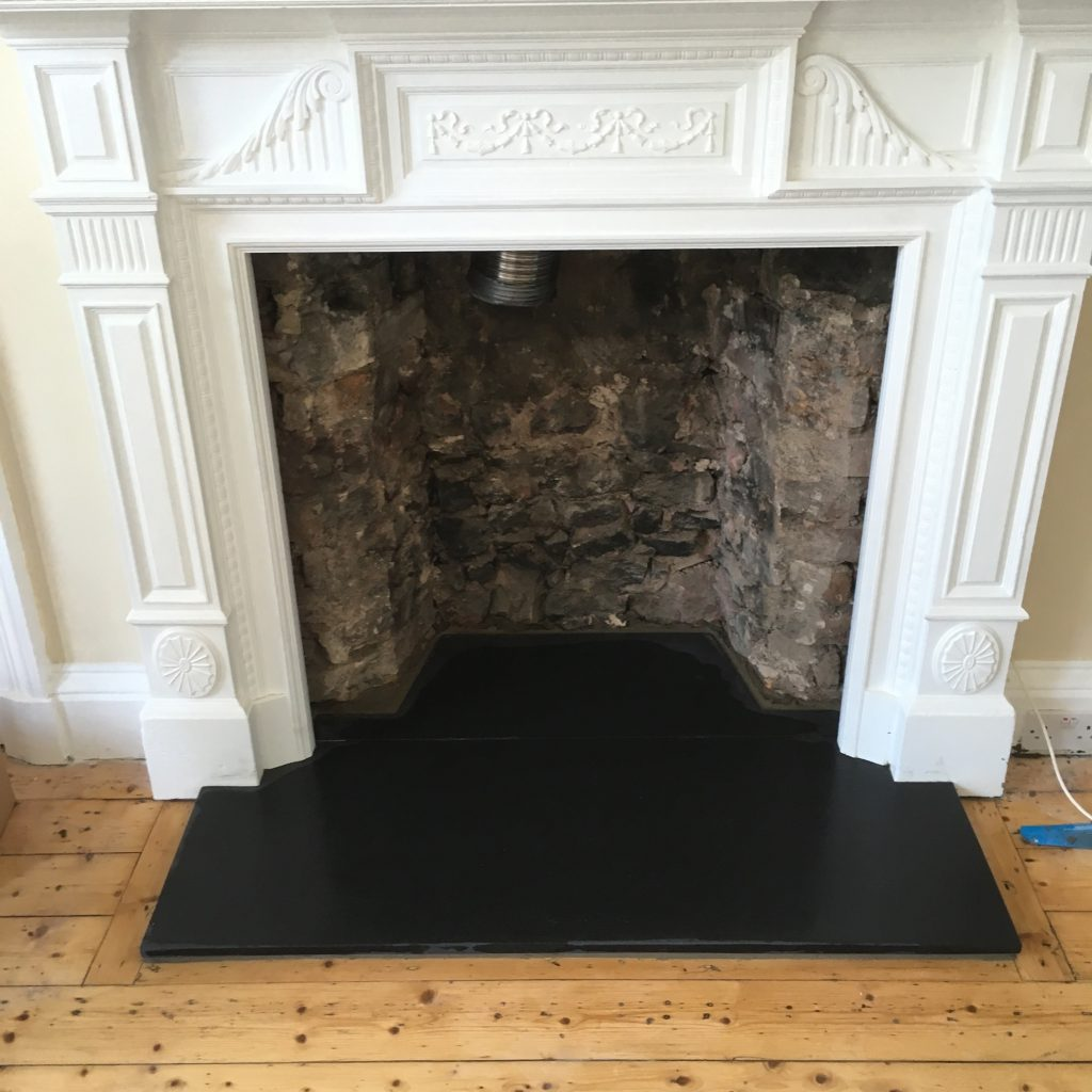 Fireplace with white surround and flue liner fitted