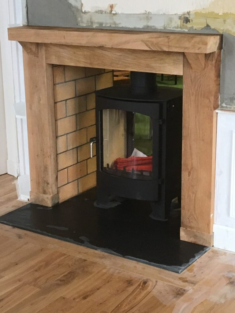 Stove with wood surround
