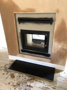 Inset stove during installation